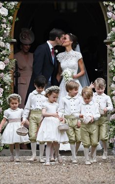 Pippa and James leave the church, flanked by their bridesmaids ad pageboys