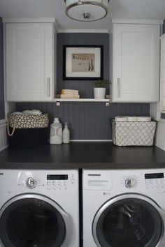 Cute little laundry space and if there was any place where I would choose a bargain (formica) countertop option, it would definitely be in the laundry room. Functional, attractive, and frugal!