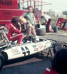 Lauda is the man standing and the BRM P160B, No. 44 is the car of J.P.Beltoise at the 1972-Race of Champions at Brands Hatch and, thus, most probably the man in the car Lauda is talking to is Beltoise.