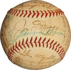 Marilyn autographs this baseball under Joe DiMaggio's autograph