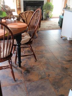 Is this live or...?  Karndean vinyl tile in a slate visual with wood insert transformed this kitchen into a great space.  Design, Materials & Installation by George's Carpet One / www.georgesc1.com.