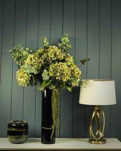 Bring a sense pure luxury to any room with The Alton , an exquisite display of the most luxurious artificial fresh touch green hydrangeas.   An exclusive Demmery's exclusive creation. Total arrangement height: 100cm.  Free dusting brush.