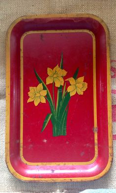 Old Vintage Red Metal Tray with Daffodils. $18.00, via Etsy.