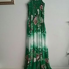 Butterfly Maxi Dress This maxi dress has a beautiful green coloring with floral and butterfly details. Top is smocked for comfort and ease. Would fit size 1x to 3x. Never wore this one. I have multiple patterns of this exact dress because I love it so much but this one never gets wear. Dresses Maxi