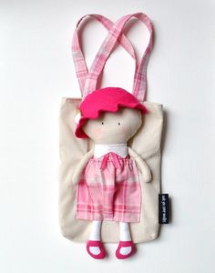 make a doll that can sit in a bag. I LOVE THIS!