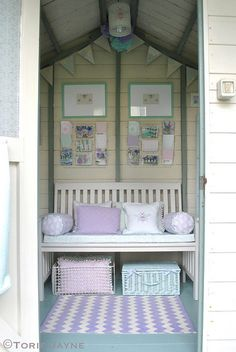 Bench in summer house-cute idea for an outdoor playhouse for girls