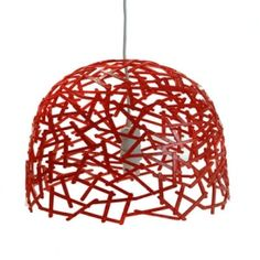 This is a lamp made from plastic spoons used in the coffee which are going to the garbage daily by the thousands because they are only used once.