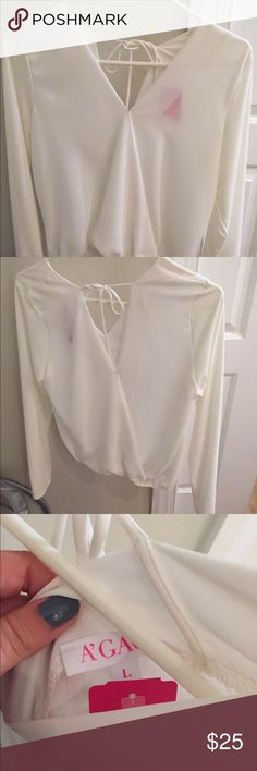 Long sleeve white blouse V White blouse with a V, adjustable in the back. Brand new never worn. a'gaci Tops Blouses