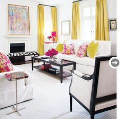 I love the pops of yellow and fushia in a black and white room