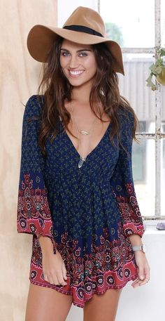 562259fb629 In love with this navy long sleeve playsuit. I like her hat too! Boho