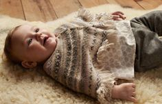"""In this image: Poncho (1224Q060N); Shirt (5XR75Q1GE); Pants (4M0XS52WE). Winter 2012 United Colors of Benetton Baby collection."""