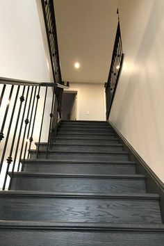 Carbon stained oak staircase for a modern look.