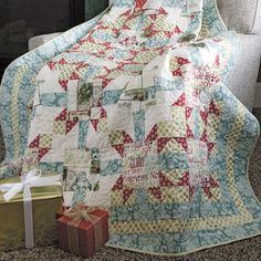 """SANTA'S MAILBAG Starry medallion lap quilt pattern from November/December 2015 McCall's Quilting magazine Designed by KATE COLLERAN Adorable modern Christmas fabrics give this easy-to-piece lap quilt contemporary charm. Santa's Mailbag is the perfect cuddle quilt for families with small children, and a welcome gift in any home with """"true believers""""!"""
