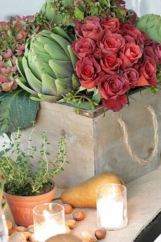 If you'd like to recreate this look, the center French flower box contains two dozen autumnal hued roses, three large artichokes, a few seedy stems from a mystery varietal of eucalyptus and three Hydrangea. Tea lights, mixed nuts in their rustic jackets, mini Guy Wolff terra cotta pots filled with herbs, Bosc pears and gorgeous Royal Riviera pears from Harry & David are scattered about.
