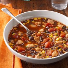 Chicken and Black Bean Soup Recipe -This spicy soup is one of my husband's favorites. It's quick to make but tastes like it simmered all day—and what a great way to use up the last tortilla chips in a bag! It's even delicious reheated. —Linda Lashley, Redgranite, Wisconsin