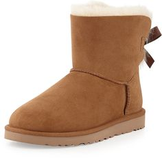 "UGG AUSTRALIA MINI BAILEY BOW-BACK BOOT  $150 by UGG at Neiman Marcus         Available Colors: BLACK ,GREY ,ICE BLUE ,CHESTNUT ,NAVY Available Sizes: 35.0B/5.0B,36.0B/6.0B,37.0B/7.0B,38.0B/8.0B,39.0B/9.0B,40.0B/10.0B,41.0B/11.0B DETAILS UGG Australia boot in sheepskin and cow suede (17mm). Dyed lamb shearling (Australia, UK, USA, or Ireland) fur lining. UGGpure wool insole. Approx. 6""H shaft. Lace-up bow-tie back. Flat heel. EVA lugged sole for traction. ""Bai"