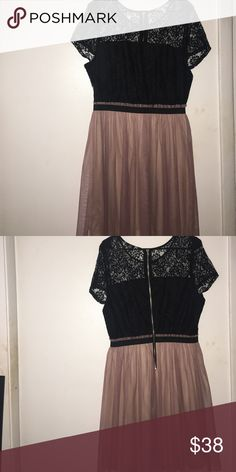 Tutu Style, Lace Dress Pink tutu style bottom, black lace top with zipper detail on the back. Never worn. Perfect for a night out! Dresses