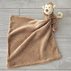 What baby can resist a soft and cuddly lovey blanket? This brown monkey lovey features a delightful monkey head that will make the perfect bedtime companion. Find out what gifts baby and parents will love with . Newborn Baby Gifts, New Baby Gifts, Baby Play, Baby Toys, Gift Crates, Plan Toys, First Birthday Gifts, Lovey Blanket, Jellycat