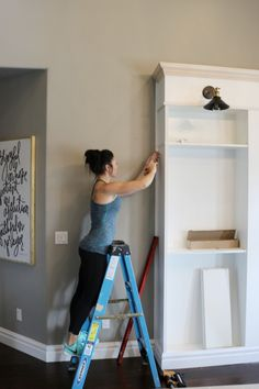 Want to know how to build your own library wall? I started with 3 ikea billy boo… Want to know how to build your own library wall? I started with 3 ikea billy bookcases and modified them to look custom! Read on as I share all the details! Ikea Billy Bookcase Hack, Bookshelves Built In, Billy Bookcases, Book Shelves, Ikea Billy Hack, Bookshelf Design, Corner Shelves, Wall Shelves, Built Ins
