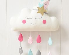 This sweet sleeping cloud is an adorable gift for baby shower and also for nursery or kids room decoration.  The cloud is made of cotton fabrics, has felt cheeks and cute bows. It's firmly stuffed with non-allergenic polyester fiber. Eyes and mouth are carefully hand embroidered. Measures approximately : 46cm x 37cm (considering the legs) 18 x 14,5  The cloud can be made to order in the colors and patterns of your choice :)  Thank you for looking
