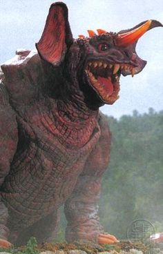 """Baragon's name comes from the Japanese word bara (バラ?), meaning rose, and ragon (ラゴン?), from """"dragon."""" This name refers to the ridges on his back, which supposedly resemble rose petals. In Godzilla, Mothra and King Ghidorah: Giant Monsters All-Out Attack, the guardian monster Baragon's name is spelled in kanji but pronounced the same: 婆羅護吽? (Baragon)."""