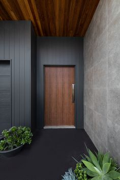 timber flooring produced an entrance thats tactile, bold and dare we say it, groovy. The Weathergroove range is a vertically grooved timber cladding designed to accompany any home and any material palette. We just adoor it! Cladding Design, Exterior Wall Cladding, House Cladding, Timber Cladding, Facade House, Cladding Ideas, Black Cladding, Ceiling Cladding, Timber Flooring