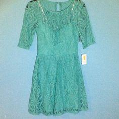 NWT B. DARLIN Green Lace Dress. NWT Beautiful B. DARLIN Green Lace Dress. Slight padding in bust. Skirt length is 18 inches. B. Darlin Dresses