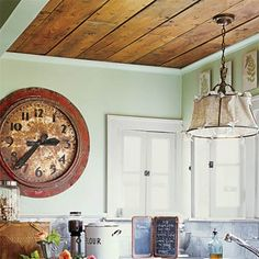 28 Thrifty Ways to Customize Your Kitchen Cottage Charm: Wood Paneling Overhead Line the ceiling with reclaimed floorboards for added texture and color in an unexpected place. Wood Ceilings, Plank Ceiling, Floor Ceiling, Ceiling Lamp, Palette, Wood Paneling, Wood Flooring, Wood Planks, How To Antique Wood