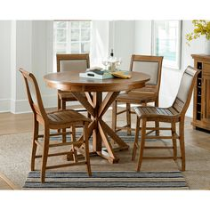 This beautiful table will make an excellent addition to any home, with its distressed white finish and sturdy build. Crafted of solid wood and pine veneers, this elegant table is sure to last for years to come.