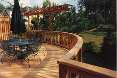 Pressure-treated deck with curved dining area and arbor for training flowing vines. Designed and built by Atlanta Decking. Decking Fence, Deck Railings, Pergola Designs, Deck Design, Outdoor Rooms, Outdoor Decor, Fencing Companies, Decking Material, Backyard