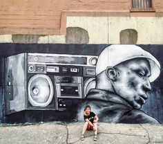 Zabou with her Grandmaster Flash portrait in the Bronx, NY, 9/16 (LP)