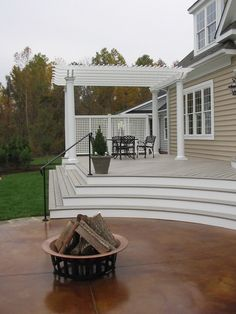 """Photo of Harmony Design Northwest - """"This stained concrete patio, deck & pergola are part of a featured design for a Parade of Homes - Portland, OR Concrete Patio Designs, Cement Patio, Concrete Walkway, Stone Walkway, Outside Living, Outdoor Living, Harmony Design, Stained Concrete, Acid Concrete"""