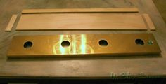 Brass vanity light strip case with matching wood pieces