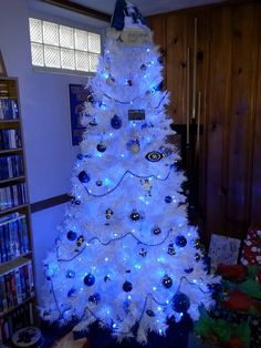 white-christmas-tree-with-blue-christmas-lights-also-a-star-over ...