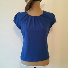 Blue Ruched Top By Worthington.  Size Petite Small.  Nice material and stretchy.  Great condition! Worthington Tops