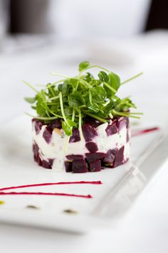 Roasted red beets and goat cheese, accented by pine nuts and micro greens, at The Crossing located at 7823  Forsyth. Photo Credit: KEVIN A. ROBERTS, CARMEN TROESSER, JONATHAN GAYMAN, KATE MCDONALD, GREG RANNELS. OCTOBER 2012 ISSUE, PAGE 96.