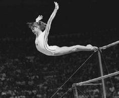 Iconic photo of Nadia Comaneci and the first perfect 10 in the Olympics.