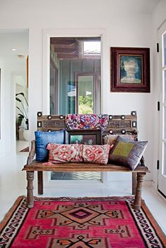 Kilims, cushions & antique oriental bench