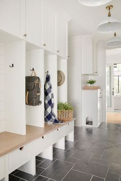 Shiplap mudroom lockers featuring a tan oak mudroom bench with brass hardware and lower storage drawers in a cottage mudroom design. Mudroom Laundry Room, Mud Room Lockers, Mud Room Garage, Mudroom Cabinets, Bench Mudroom, White Shiplap, The Tile Shop, Farmhouse Side Table, Slate Flooring