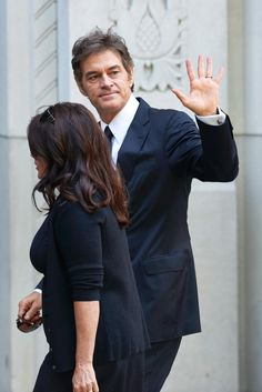 Dr. Mehmet Oz looks somber as he gives a wave before heading into Joan Rivers' memorial service on Sept. 7, 2014.