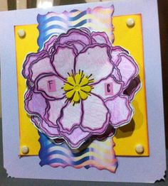 Birthday card..stamped flower..colir pencils...yellow flower brad in center..yellow brads in corners...stickers for initials...aged borders in dark purple..