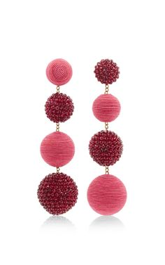 These earrings by **Rebecca de Ravenel** are rendered in an elegant drop style featuring feminine spheres in tonal pink hues.