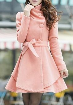 A soft blush pink swing style coat. I like the off-centered buttons and cinched belt for the waist.