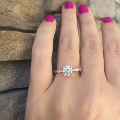 A perfect solitaire engagement ring with a rose gold band, by Tacori, of course.