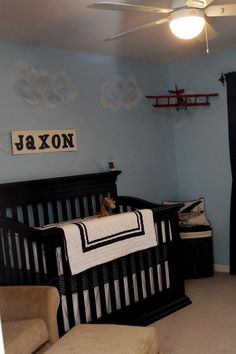 Baby boy nursery with Matthew's old airplane models :)