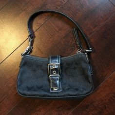 Coach small purse authentic. Cute & chic small bag.  Leather bottom, strap, and side. Signature C Fabric front and back . EXCELLENT condition. No tears. Inside has some makeup marks but nothing majorly seen unless your in the light as the inside is black. Minor scratches of metal on front of silver, As shown in pictures. Not noticeable unless you look close. Overall a good bag. :) roughly 8x 4.5 Coach Bags Mini Bags