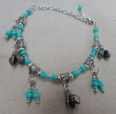 Bells with Aqua Turquoise Silver bead by TheVelvetMannequin