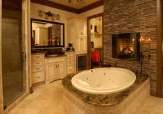 Beautiful bath with a fireplace and wine cooler...Angouleme House Plan - 8383