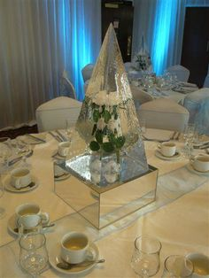Ice Sculpture Wedding Centerpiece with frozen flowers in the middle...unique!