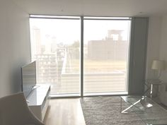 Sunscreen roller blinds for floor to ceiling windows in apartment | 22 Marsh Wall | Landmark Tower | Canary Wharf | Isle of Dogs | Made to measure